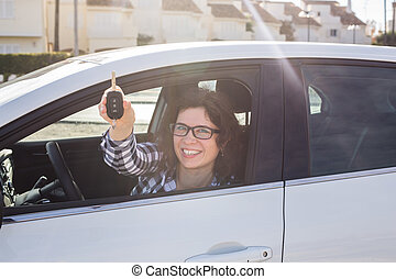 Young Happy Woman Showing The Key Of New Car