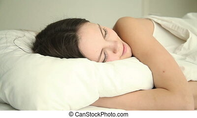Young happy woman sleeping in bed - Young beautiful happy...