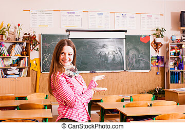 Young happy woman teacher