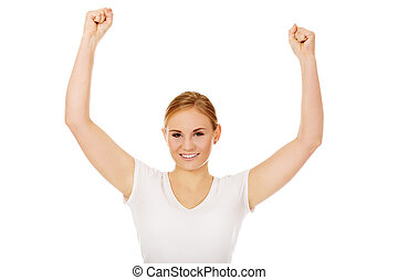 Young happy woman with arms up