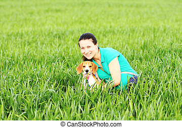 Young happy woman with beagle dog