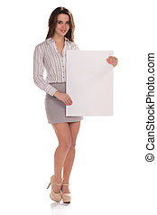 Young happy woman with blank board