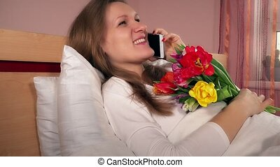 Young happy woman with flowers calling her man husband and...