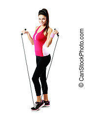 Young happy woman with jumping rope over white background