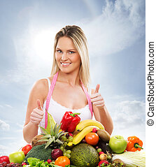 Young, healthy and beautiful girl with a pile of fruits and vegetables over the sky background