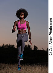black woman is doing stretching exercise relaxing and warm...