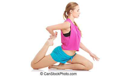 Young healthy girl doing stretching exercises - Sport...