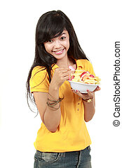 young healthy girl having a fruit salad