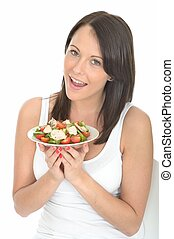 Young Healthy Happy woman Holding a Plate of Salmon Salad