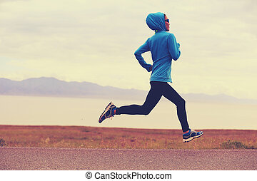 young healthy lifestyle woman runner running on road