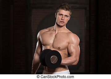 Young Healthy Man Doing Exercise For Biceps