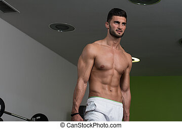Young Healthy Man Working Out With Weights