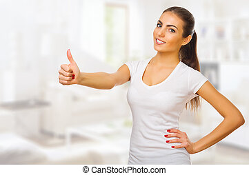 Young healthy woman shows ok gesture