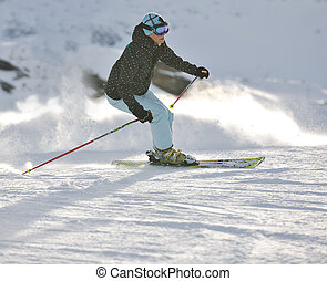woman skiing on fresh snow at winter season - young healthy...