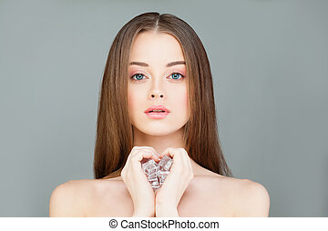 Young Healthy Woman with Ice Cubes. Beautiful Model Girl, Spa and Skin Care Concept