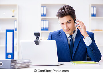 Young help desk operator working in office