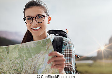 Young hiker holding a map