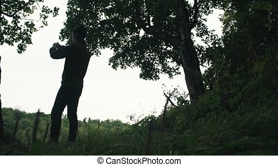 Young hiker taking photo standing on top of mountain using smartphone landscape