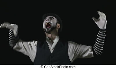 Young hilarious scary crazy evil mime making funny faces