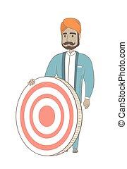 Young hindu businessman and dart board.