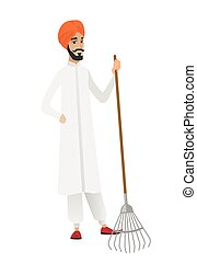 Young hindu farmer holding gardening rake.