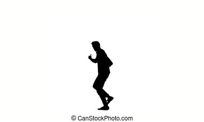 Young hip-hop man doing brake dancing movements, on white, slow motion, silhouette