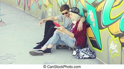 Young hipster couple browsing the internet