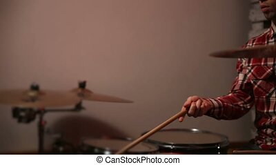 Young hipster drummer juggling drumsticks - Smiling young...