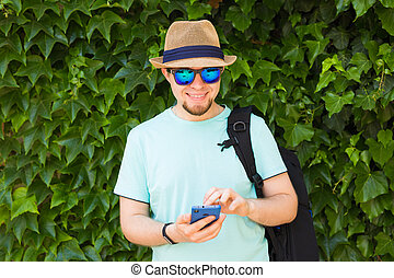 Young hipster man using mobile smart phone