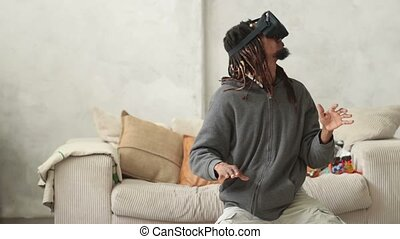 Young hipster man using virtual reality headset