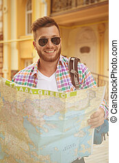Young hipster man with map