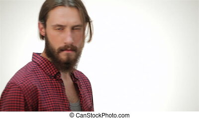 Young hipster style man posing in studio