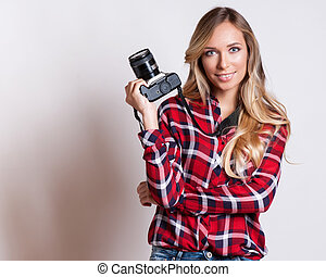 young hipster woman with digital camera smiling