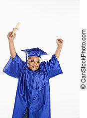Young hispanic boy graduate. - Young boy wearing blue...