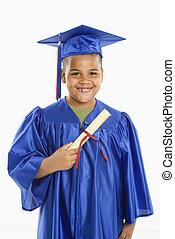 Young hispanic boy graduating. - Young boy wearing blue...
