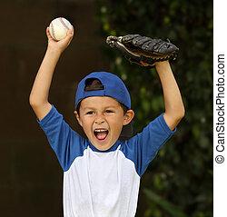 Young hispanic boy with baseball and glove celebrates