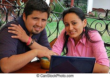 Young Hispanic couple using a laptop computer
