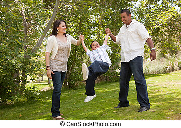 Young Hispanic Family Having Fun in the Park