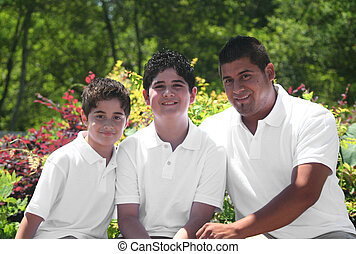 Young Hispanic Father with His Children