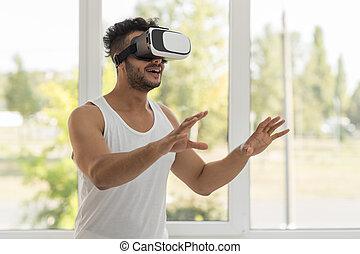Young Hispanic Man Wear Virtual Reality Digital Glasses, Happy Smiling Guy