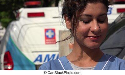 Young Hispanic Nurse and Ambulance