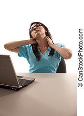 Young hispanic nurse working on computer