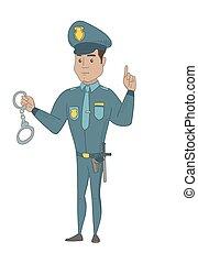 Young hispanic policeman holding handcuffs.