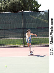 young hispanic teen girl swinging tennis racket