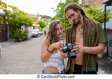 Young Hispanic tourist couple together in the streets outdoors
