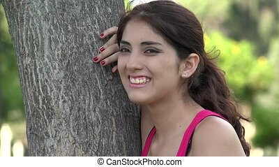 Young Hispanic Woman Laughing Outdoors