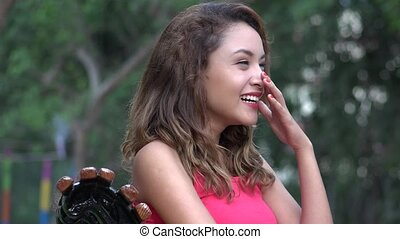 Young Hispanic Woman Laughing