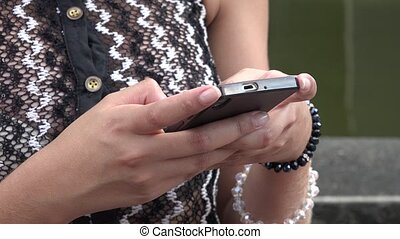 Young Hispanic Woman Using Mobile Phone