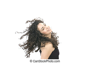 young Hispanic woman with hair blowing in the wind