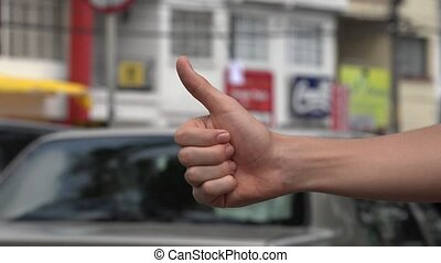 Young Hitchhiker with Thumb Up